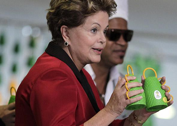 Brazil's President Dilma Rousseff holds the caxirola.