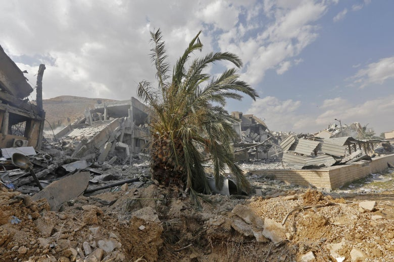 This picture taken on April 14, 2018 shows the wreckage of a building described as part of the Scientific Studies and Research Centre (SSRC) compound in the Barzeh district, north of Damascus, during a press tour organised by the Syrian information ministry. The United States, Britain and France launched strikes against Syrian President Bashar al-Assad's regime early on April 14 in response to an alleged chemical weapons attack after mulling military action for nearly a week. Syrian state news agency SANA reported several missiles hit a research centre in Barzeh, north of Damascus, 'destroying a building that included scientific labs and a training centre'. / AFP PHOTO / Louai Beshara        (Photo credit should read LOUAI BESHARA/AFP/Getty Images)