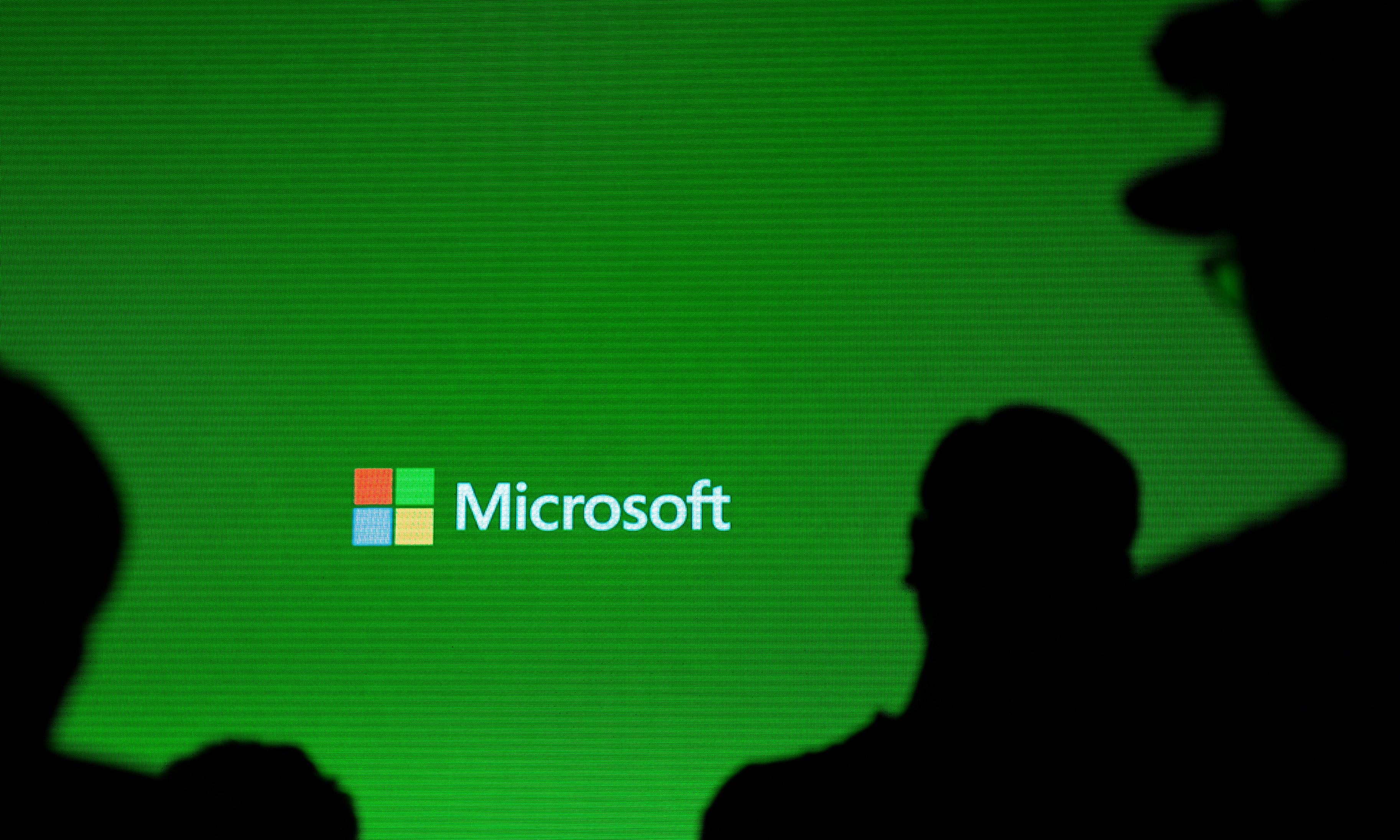 A Microsoft logo is pictured during a presentation.