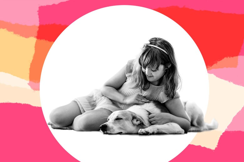 Young girl playing with dog.