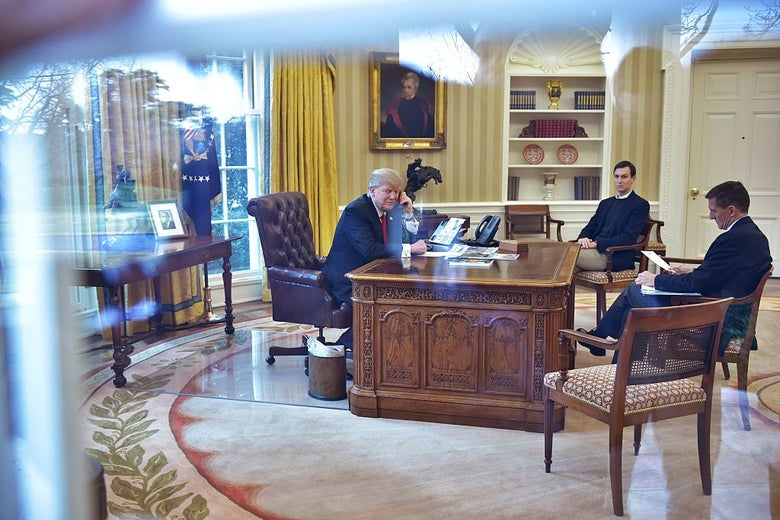 Trump sits at the president's desk and holds a phone as Kushner and Flynn watch while seated in chairs across from him.
