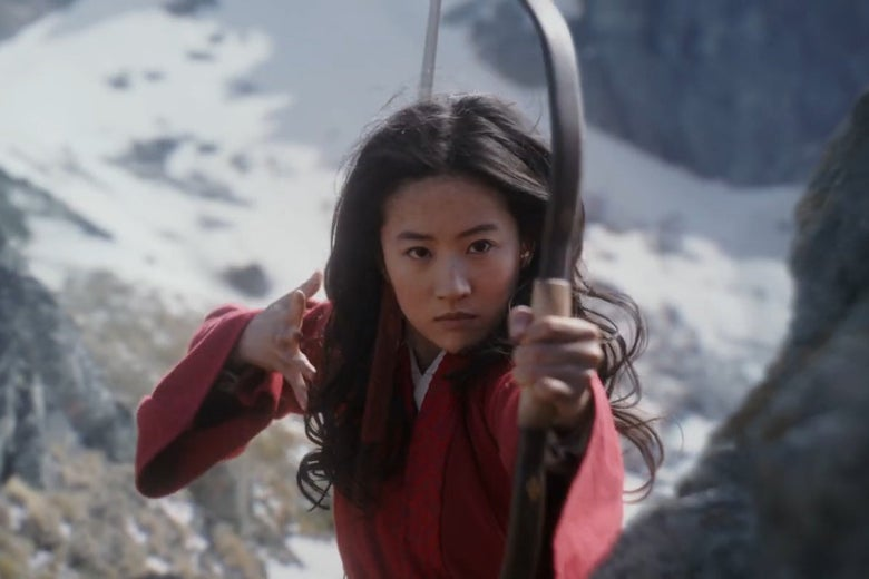 Liu Yifei looses an arrow at the camera in a still from Mulan.