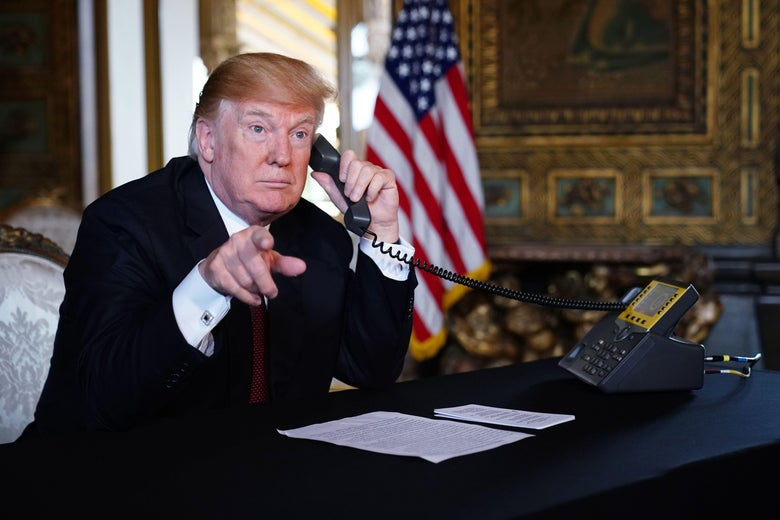 President Donald Trump speaks to members of the military via teleconference from his Mar-a-Lago resort in Palm Beach, Florida, on Thanksgiving Day, November 22, 2018.