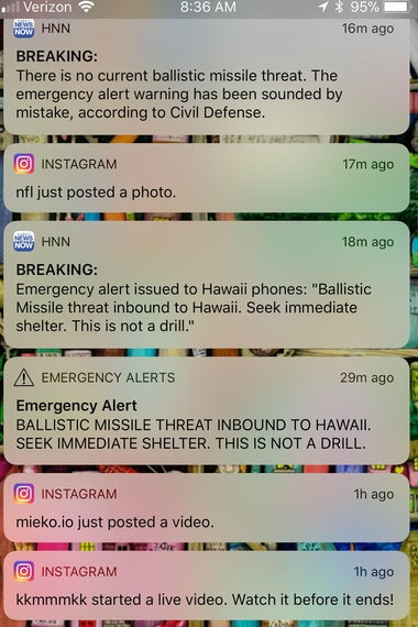 This photo illustration screenshot taken by the photographer of his cell phone shows messages of emergency alerts on January 13, 2018 of Honolulu, Hawaii.  Social media ignited on January 13, 2018 after apparent screenshots of cell phone emergency alerts warning of a 'ballistic missile threat inbound to Hawaii' began circulating, which US officials quickly dismissed as 'false.''Hawaii - this is a false alarm,' wrote Democratic Representative Tulsi Gabbard on Twitter. 'I have confirmed with officials there is no incoming missile.' The Hawaii Emergency Management Agency also confirmed there is 'NO missile threat to Hawaii.' US military spokesman David Benham said the US Pacific Command 'has detected no ballistic missile threat to Hawaii. Earlier message was sent in error,' adding that the US state would 'send out a correction message as soon as possible.'  / AFP PHOTO / Eugene Tanner        (Photo credit should read EUGENE TANNER/AFP/Getty Images)