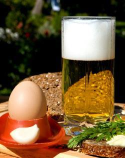 Egg in the vicinity of beer.