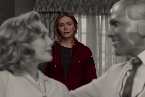 Wanda, in color, gazes at a black-and-white image of herself and her dead husband, Vision, smiling at each other and wearing 1950s clothing
