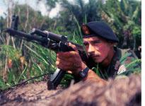 A guerrilla from the Revolutionary Armed Forces of Colombia (FARC). Click image to expand.