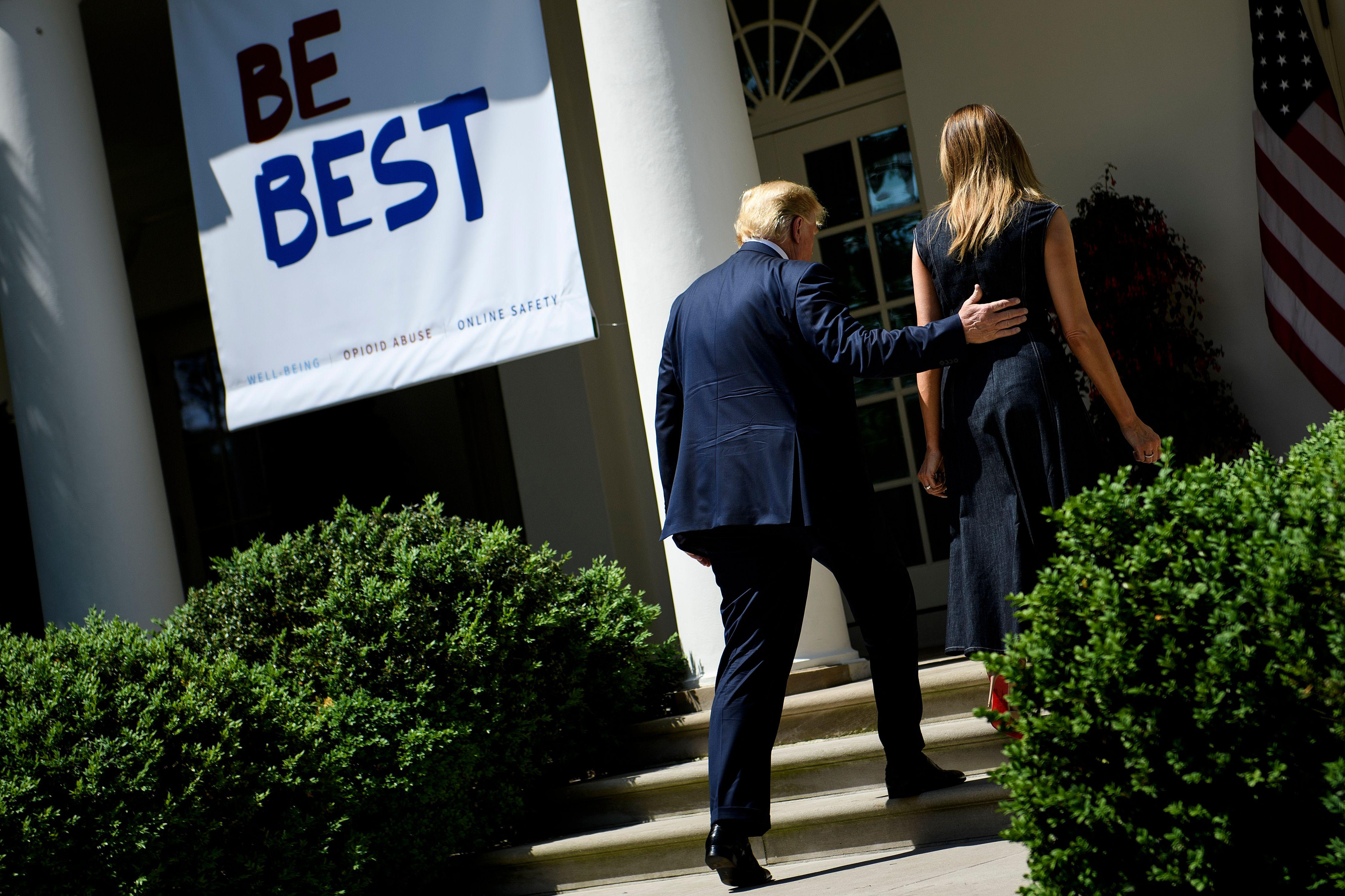 """President Donald Trump and first lady Melania Trump leave after an event to celebrate the one year anniversary of the """"Be Best"""" initiative in the Rose Garden of the White House on Tuesday."""