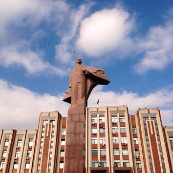 A statue of Lenin in front of the Parliament building. Tiraspol, Moldova. November 2013.