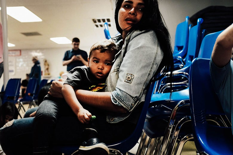 A woman who identified herself as Jennifer sits with her son Jaydan at the Catholic Charities Humanitarian Respite Center.
