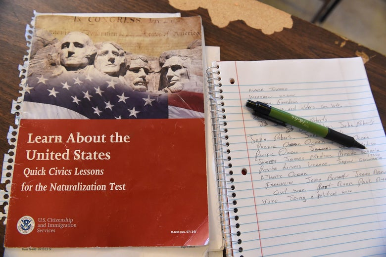 A U.S. citizenship test review booklet and notes are seen during a citizenshipt test prearation class in Perris, California, June 16, 2016. The 11 million undocumented immigrants in the United States are at the heart of a contentious debate that has stirred up passions and become a defining issue in the US presidential race, leading many immigrants who are eligible to become US citizen to take the step necessary to obtain their citizenship so they can vote in the November election. / AFP / ROBYN BECK        (Photo credit should read ROBYN BECK/AFP via Getty Images)