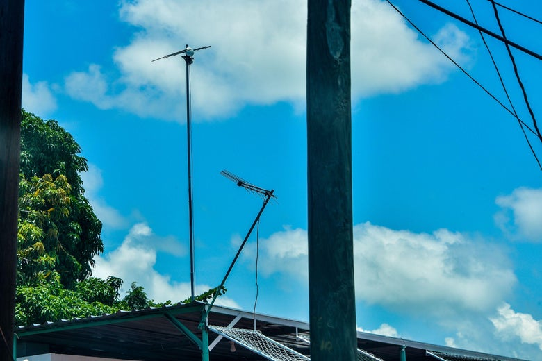 Antennas stick up from a rooftop.