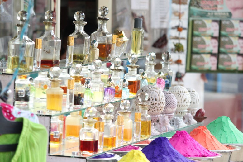 a bunch of bottles of perfume