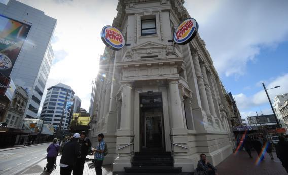 Burger King signs adorn a Victorian-era building on a street in Wellington, Sept. 8, 2011