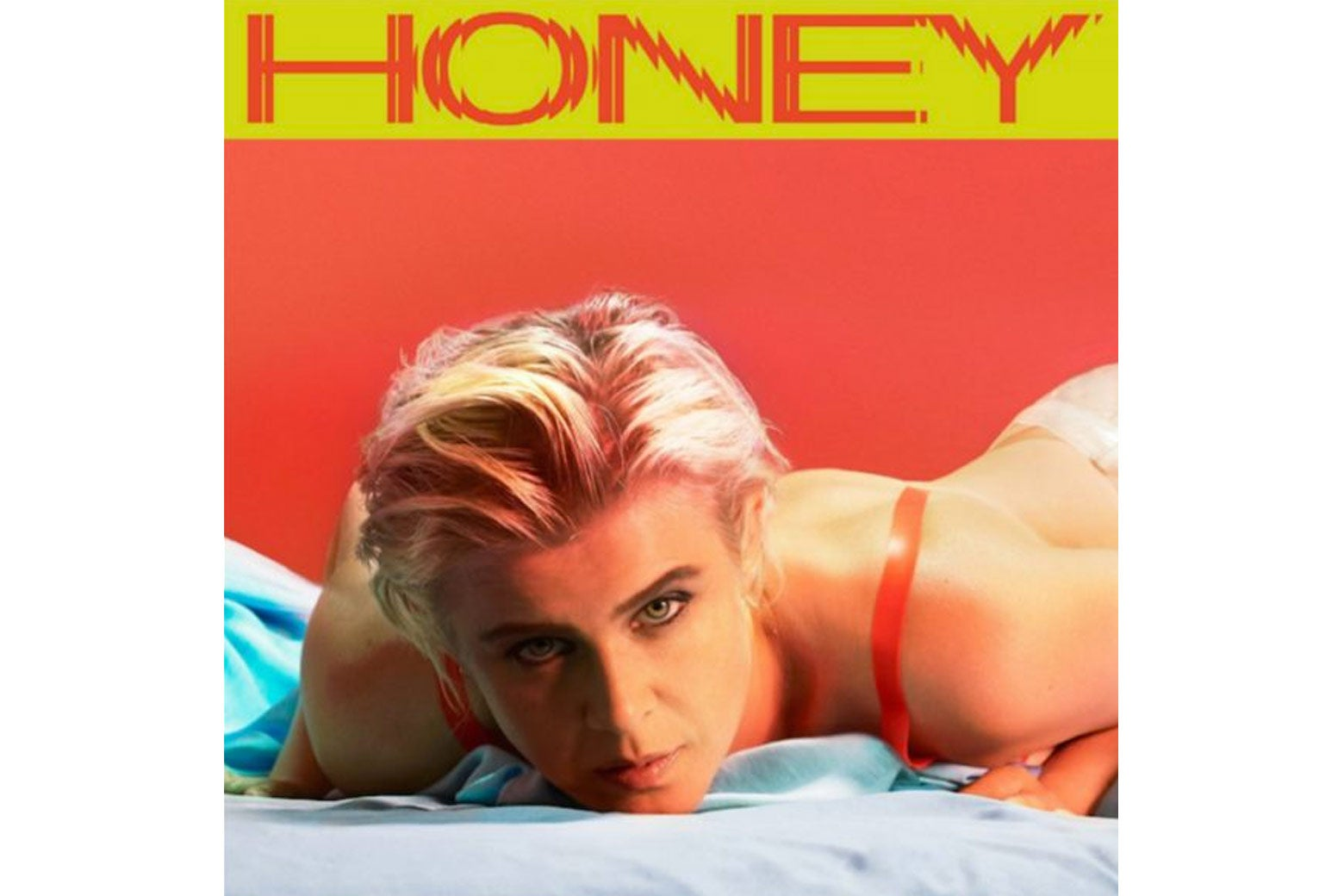 The cover of Robyn's new album, Honey. Robyn is lying on her chest in lingerie, looking forward.