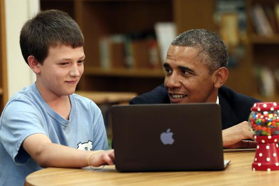 President Obama is shown digital learning programs during a visit to Mooresville Middle School in Mooresville, N.C., June 6, 2013.