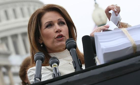 U.S. Rep. Michele Bachmann tears a page from the national health care bill during a press conference at the U.S. Capitol March 21, 2012 in Washington, DC.