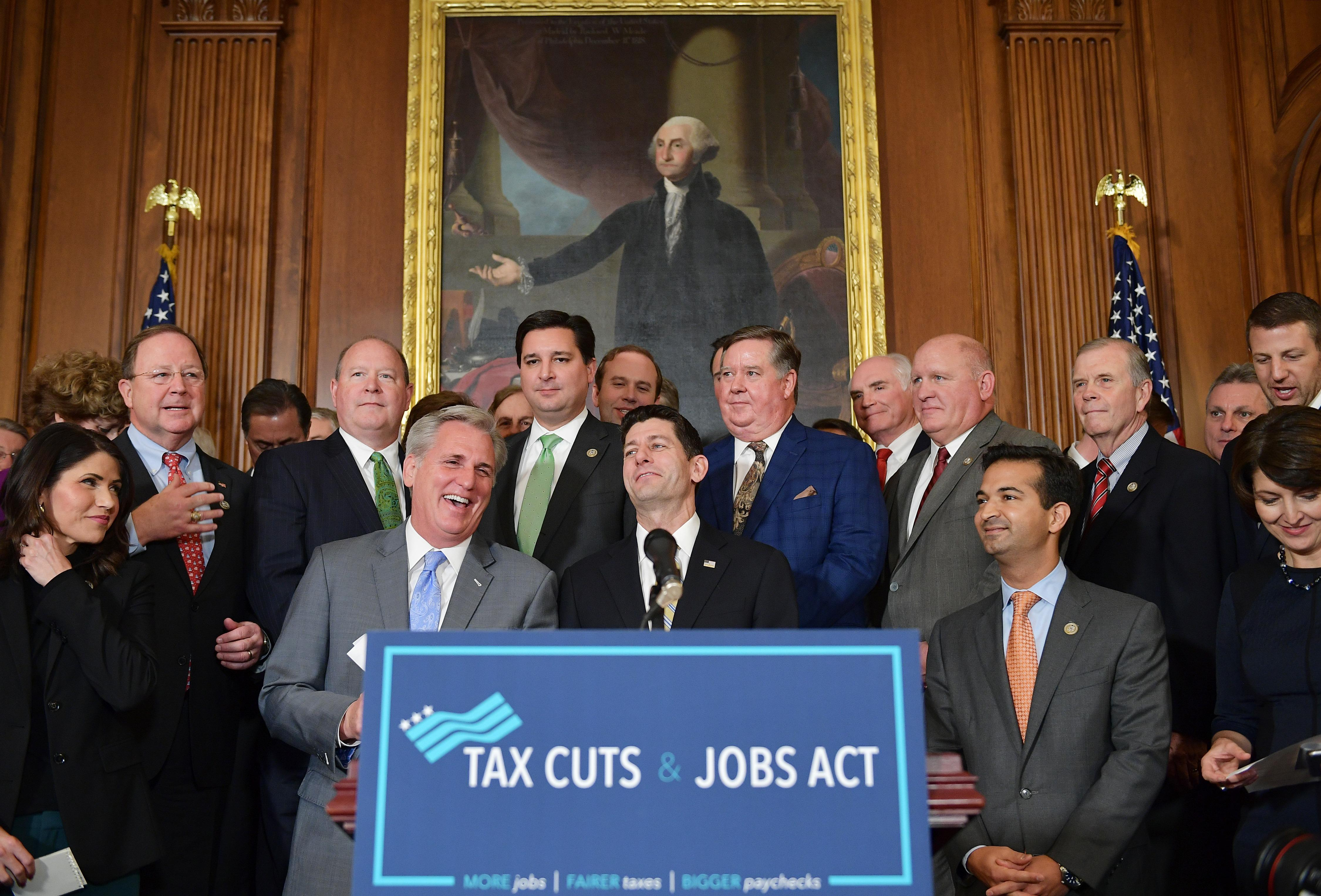 House Majority Leader Kevin, R-CA, laughs with House Speaker Paul Ryan, R-WI, during a press conference after the House passed its version of the Republican tax overhaul in the Rayburn Room of the US Capitol on November 16, 2017 in Washington, DC. / AFP PHOTO / MANDEL NGAN        (Photo credit should read MANDEL NGAN/AFP/Getty Images)