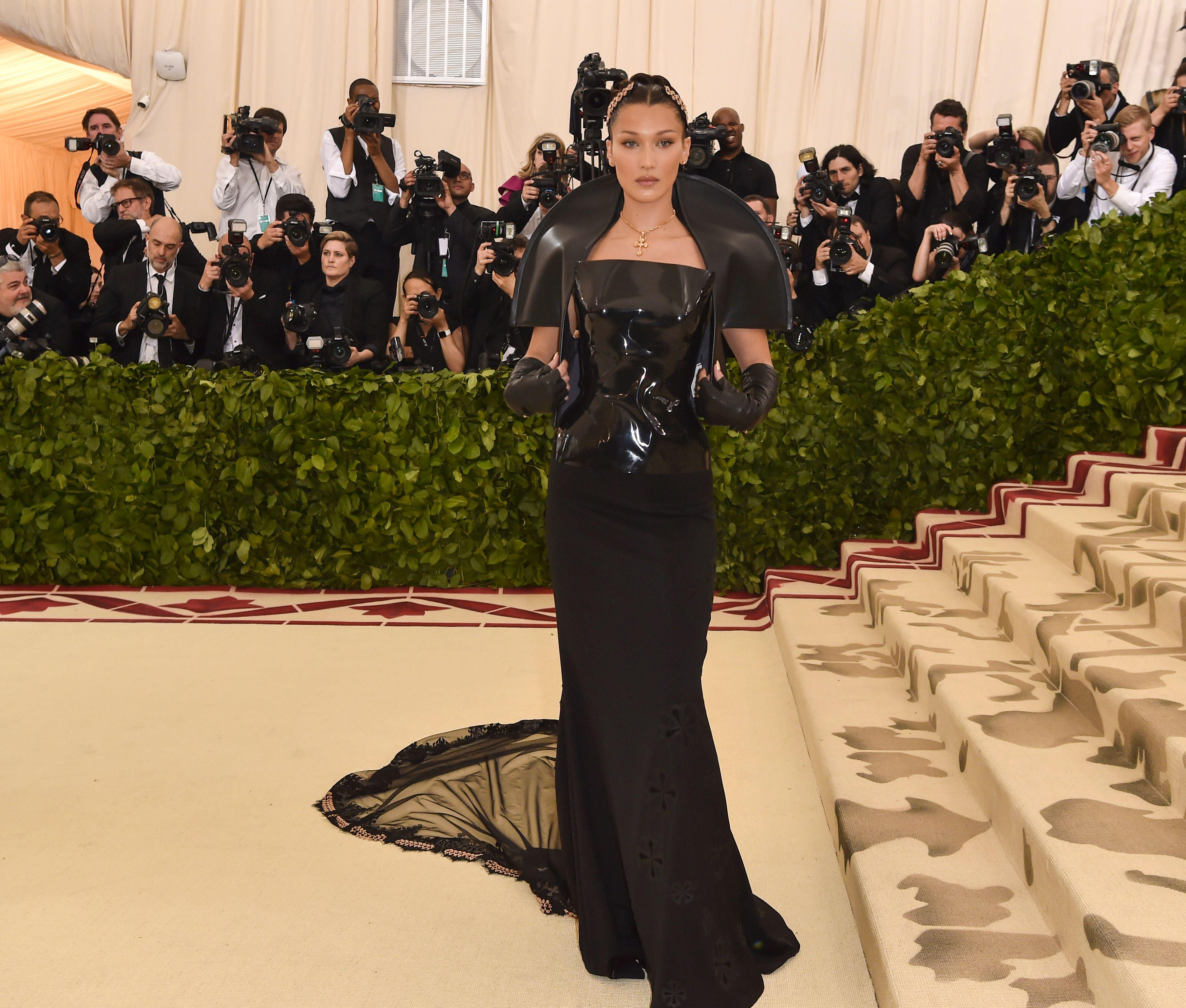 Bella Hadid arrives for the 2018 Met Gala on May 7, 2018, at the Metropolitan Museum of Art in New York. - The Gala raises money for the Metropolitan Museum of Arts Costume Institute. The Gala's 2018 theme is Heavenly Bodies: Fashion and the Catholic Imagination. (Photo by Hector RETAMAL / AFP)        (Photo credit should read HECTOR RETAMAL/AFP/Getty Images)
