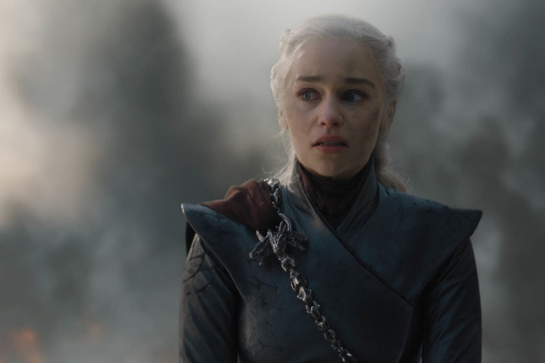 Daenerys Targaryen, her face smudged with soot and a wild look in her eyes.