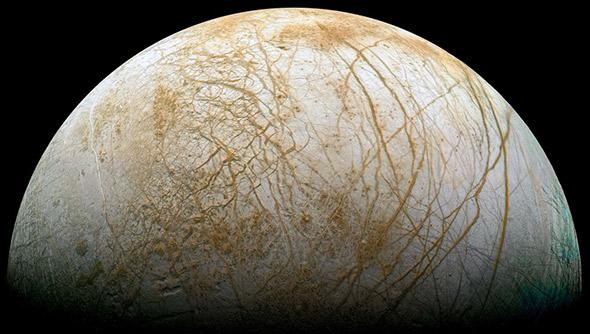 Icy slush from a hidden ocean erupting into fractures in Europa, one of Jupiter's Galilean moons.