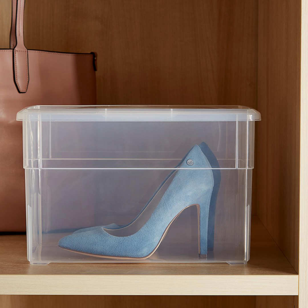 Clear tall shoe box with heels inside.