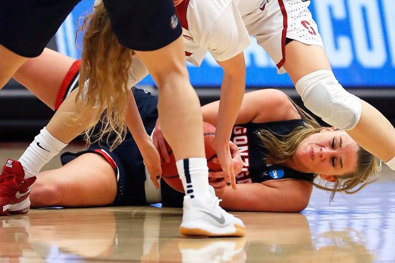 Gonzaga forward Jill Barta, bottom, battles for a loose ball against Stanford guard Brittany McPhee.