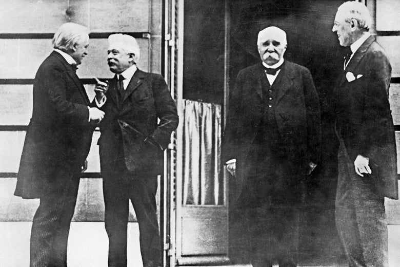 George and Orlando speak to each other with Clemenceau and Wilson nearby
