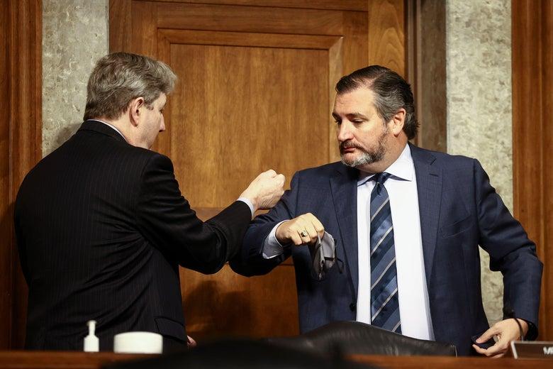 Senator John Kennedy (R-LA) and Senator Ted Cruz (R-TX) share an elbow bump greeting at a Senate Judiciary Committee hearing on Capitol Hill in Washington, D.C. on November 17, 2020.
