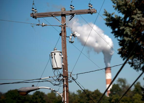 Energy-related carbon emissions rose 2 percent in 2013 as some utilities switched back from natural gas to coal.