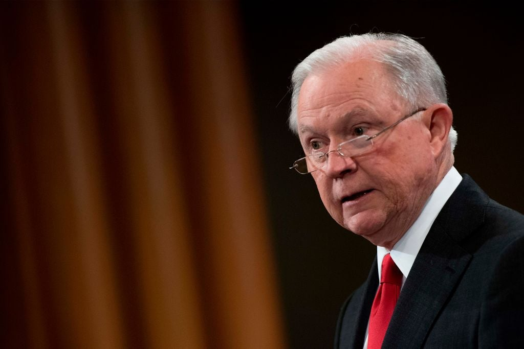 Sessions' face seen in profile at a news conference.