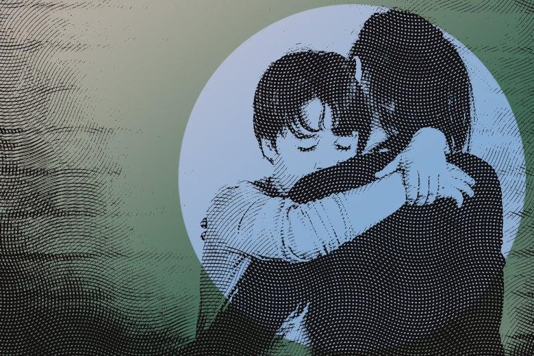Woman hugging a young boy