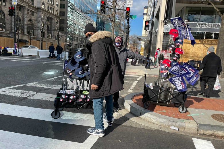 A street vendor in D.C. with carts full of Biden-Harris flags, hats, and other memorabilia