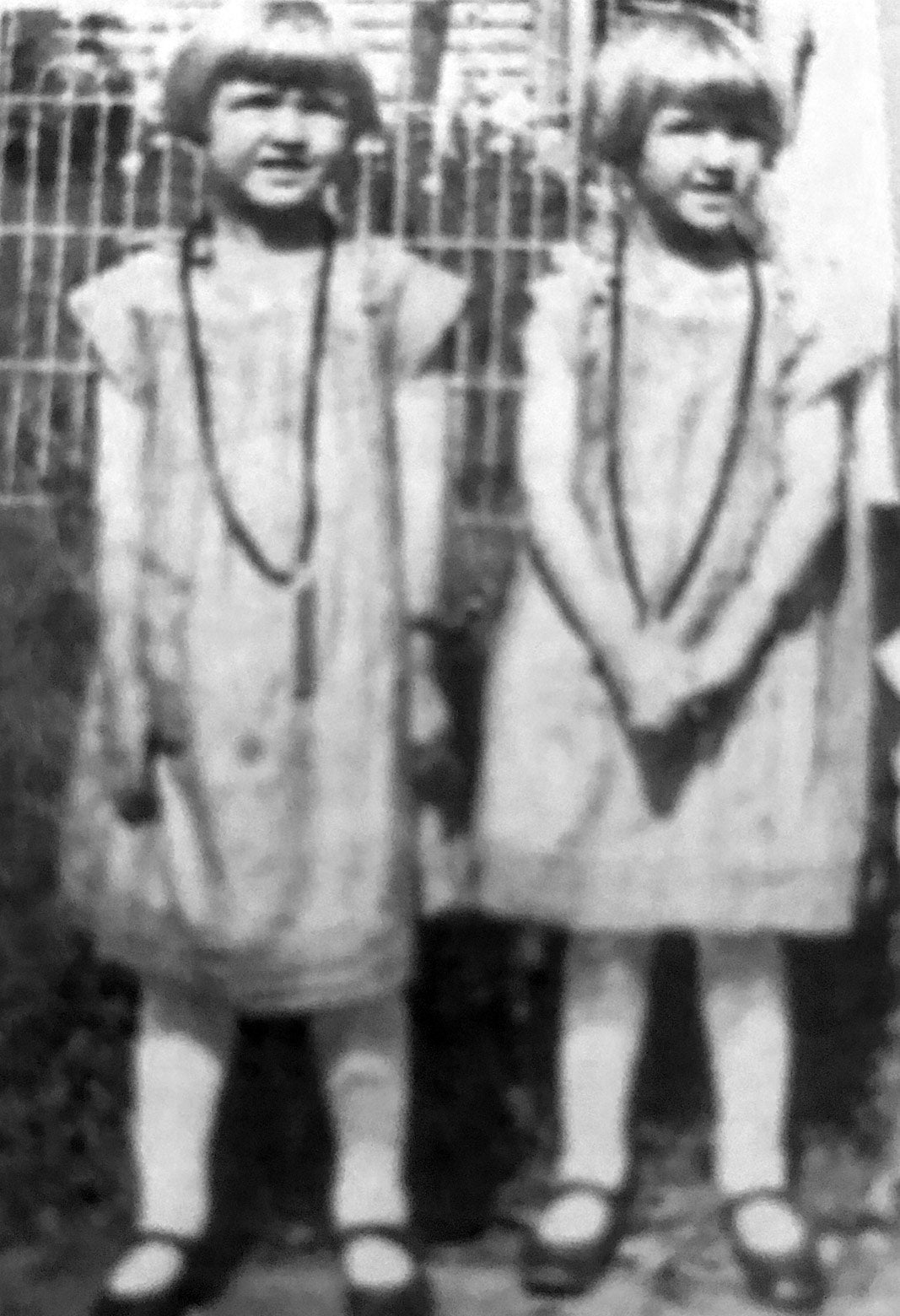 Two girls, Irene and Arlene, in matching dresses.