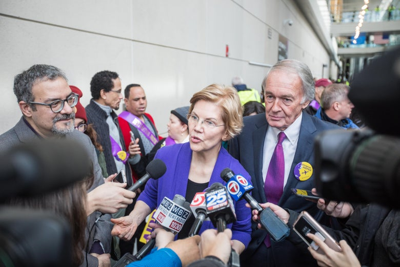 BOSTON, MA - JANUARY 21:  Sen. Elizabeth Warren (D-MA) and Sen. Ed Markey (D-MA) speak to reporters following a rally for airport workers affected by the government shutdown at Boston Logan International Airport on January 21, 2019 in Boston, Massachusetts. As the partial government shutdown enters its fifth week, the stalemate between President Donald Trump and congressional Democrats continues as they cannot come to a bipartisan solution on border security.  (Photo by Scott Eisen/Getty Images)