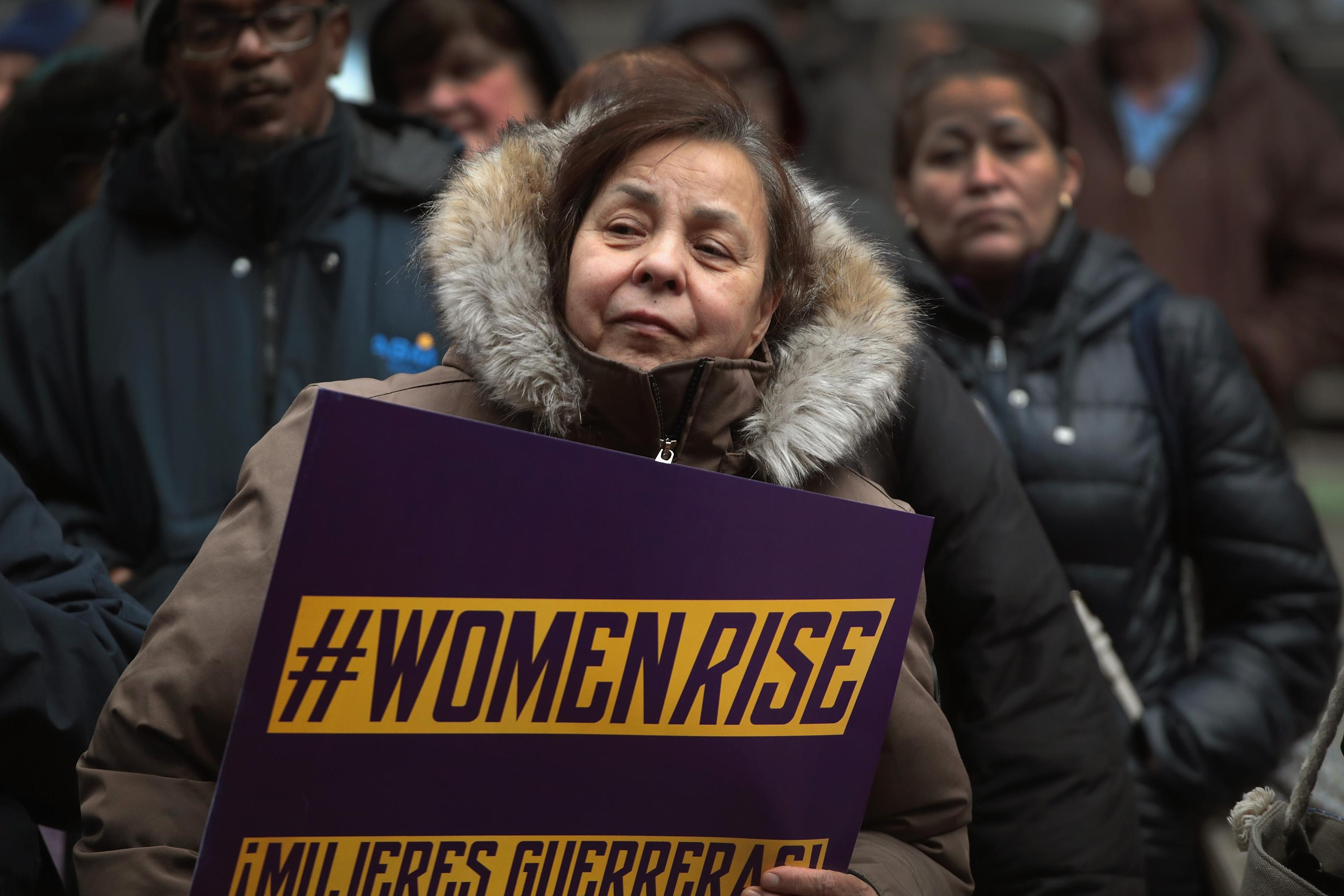 Women, activists, and SEIU members hold a rally to celebrate International Womens Day on March 8, 2018 in Chicago, Illinois.