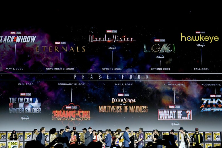 About 25 Marvel cast members onstage during Marvel's Comic-Con presentation, in front of a timeline of upcoming Marvel movies.