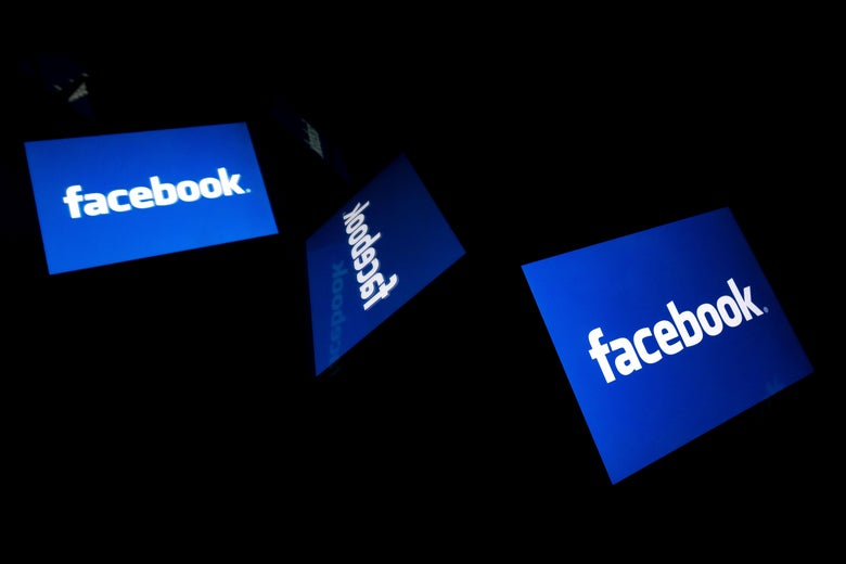 The Facebook logo displayed on three screens.