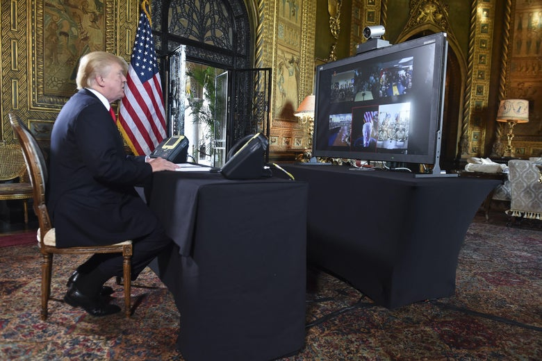 President Donald J. Trump participates in a video teleconference call with military members on Christmas Eve in Palm Beach, Florida on December 24, 2017.