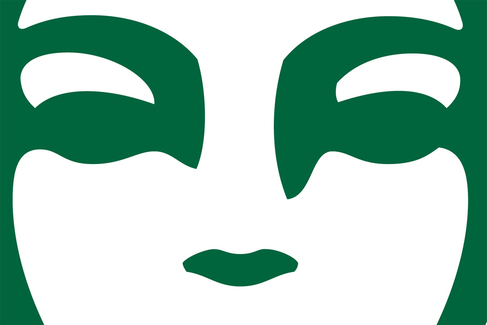 An extreme closeup of the eyes of the siren on the Starbucks logo.