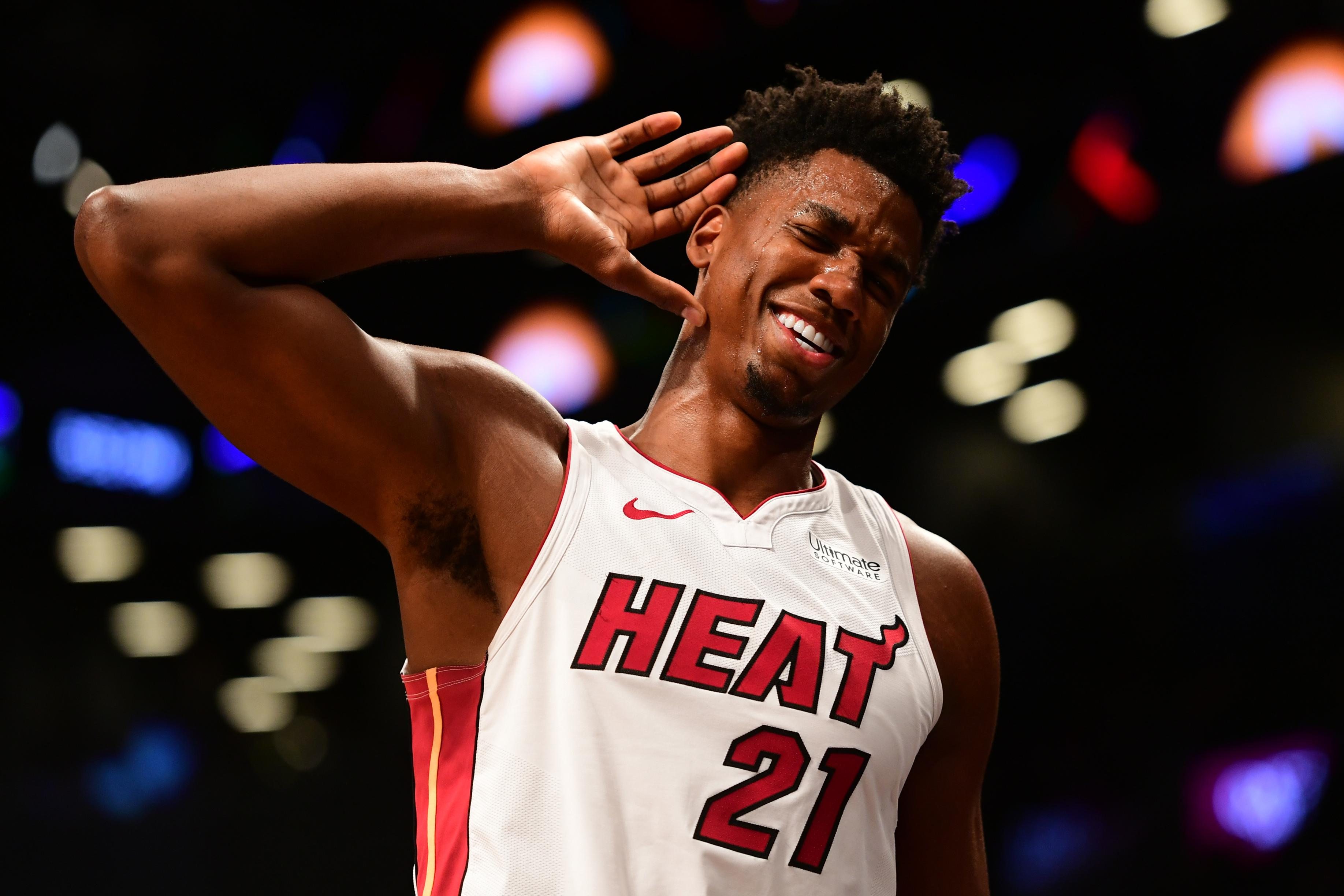 Hassan Whiteside #21 of the Miami Heat motions for the fans to get louder during the final moments of the game against Brooklyn Nets at Barclays Center on November 14, 2018 in the Brooklyn borough of New York City.