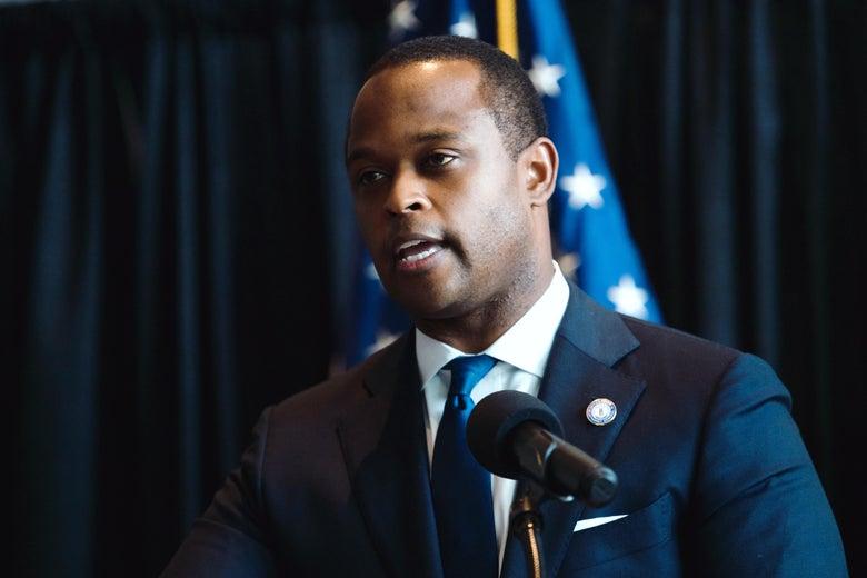 Daniel Cameron speaking at a podium