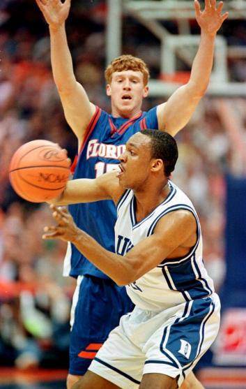 Chris Carrawell #23 of Duke passes the ball as Florida's Matt Bonner #15 of Florida.