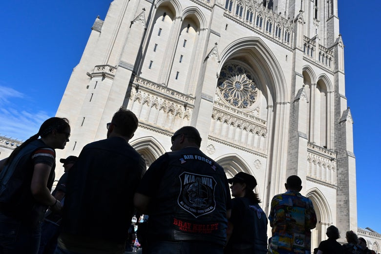 People gather in front of the Washington National Cathedral.