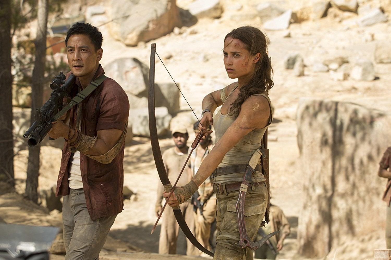 Lu Ren (Daniel Wu) and Lara Croft (Alicia Vikander) wield their weapons in Tomb Raider.
