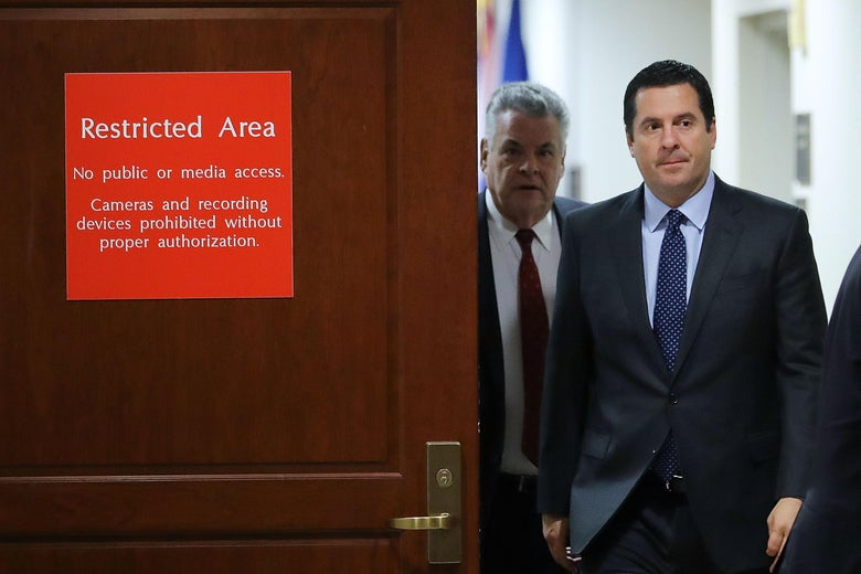 House Intelligence Committee Chairman Devin Nunes and Rep. Peter King (R-NY) leave the committee's secure meeting rooms in the basement of the U.S. Capitol House Visitors Center.