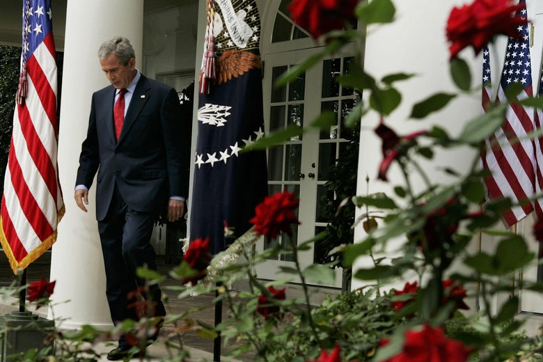 President George W. Bush walks into the Rose Garden before a news conference at the White House in October 2005.