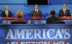 Republican presidential candidates, (L-R) Rep. Ron Paul (R-TX), Texas Gov. Rick Perry and former Massachusetts Gov. Mitt Romney answer questions during the Fox News/Google GOP Debate. Click image to expand.