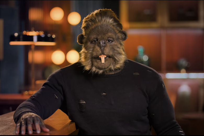 Man in black shirt wearing a beaver head with buck teeth.