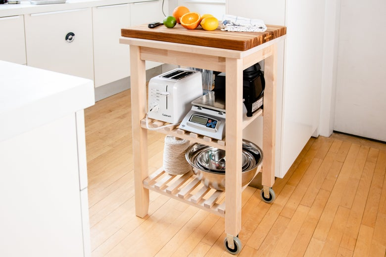 IKEA cart with shelves for storing equipment.